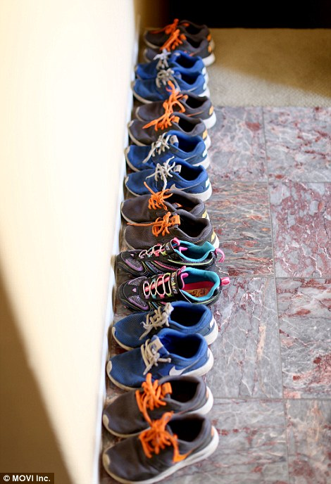 38166bbb00000578-3781725-eight_pairs_of_trainers_are_lined_up_neatly_in_the_house-a-7_1473705258112